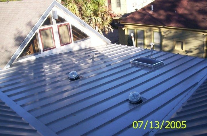 Standing Seam Metal Roof Installed On Low Slope With Solar Tubes And  Skylight