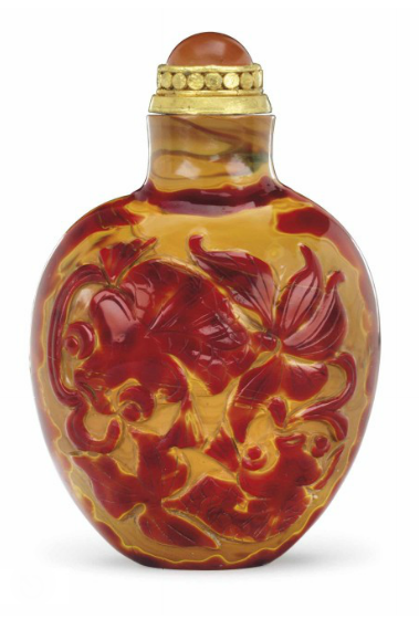 A CARVED 'REALGAR' GLASS SNUFF BOTTLE   IMPERIAL, PALACE WORKSHOPS, BEIJING, 1730-1840.