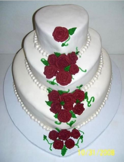 Heart Shaped 3 Tier Wedding Cake With Rose Pedals And
