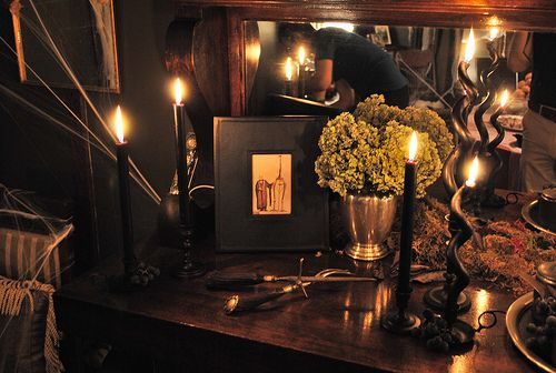 More candles, less light fixtures Candles will give an eerie effect - mad scientist halloween decorations