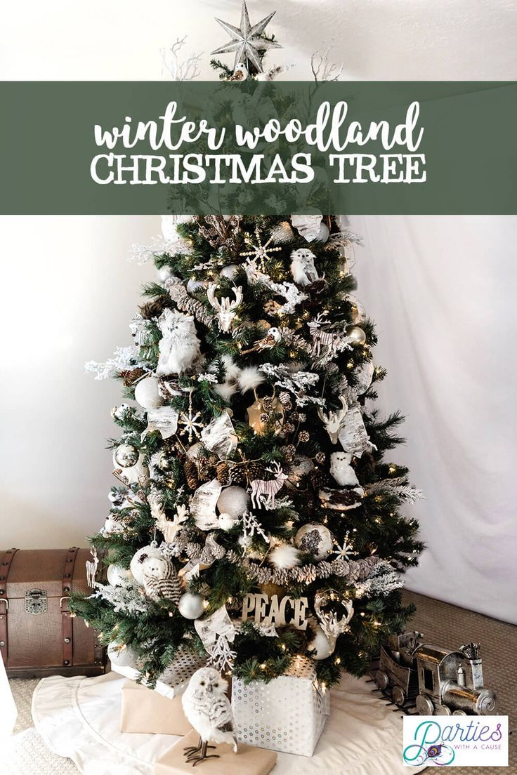 Try a rustic winter woodland Christmas tree theme this year. With simple natural ornaments like owls, deer, birds, and flocked branches. Find more Christmas tree ideas at PartiesWithACause.com #christmastree #christmasdecor #farmhousechristmas #christmashome