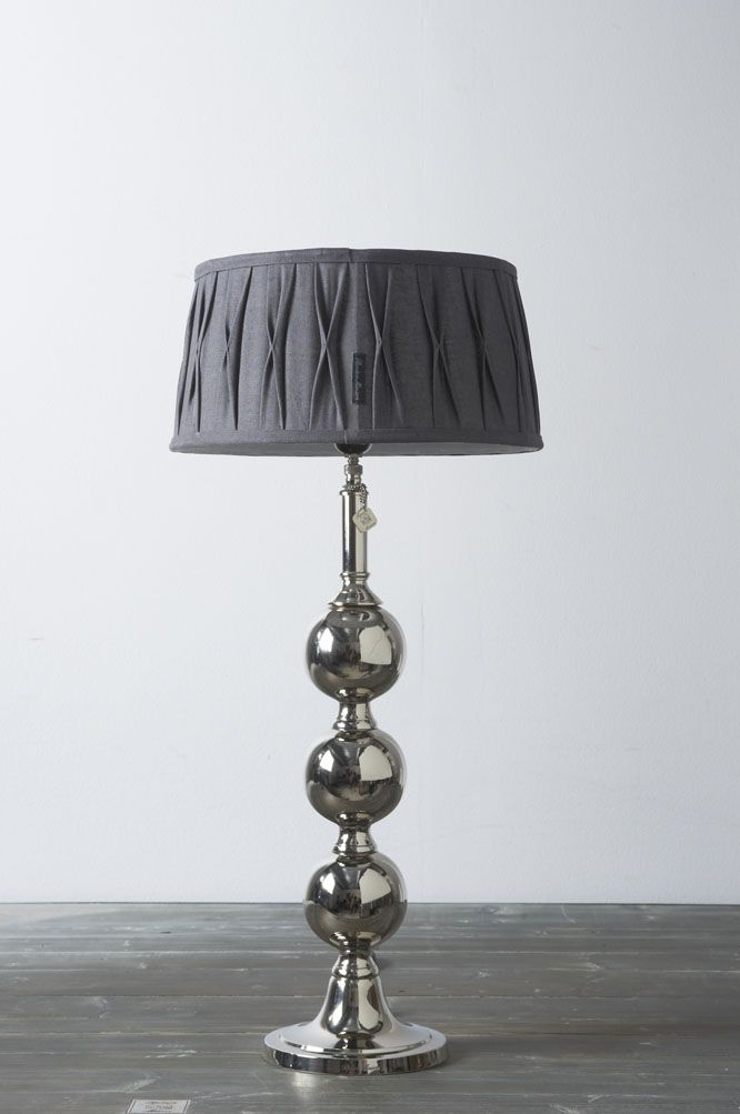 Pleated grey linen shade and silver ball lamp base