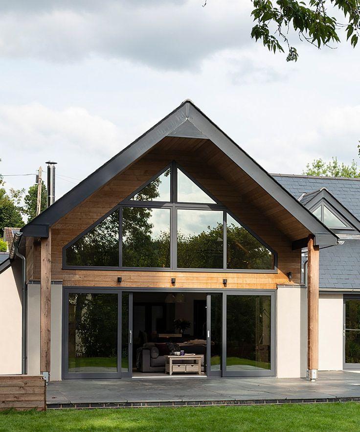 Modern Contemporaryhome Exterior Design: Rear Exterior Of A Timber-framed House With Grey Windows