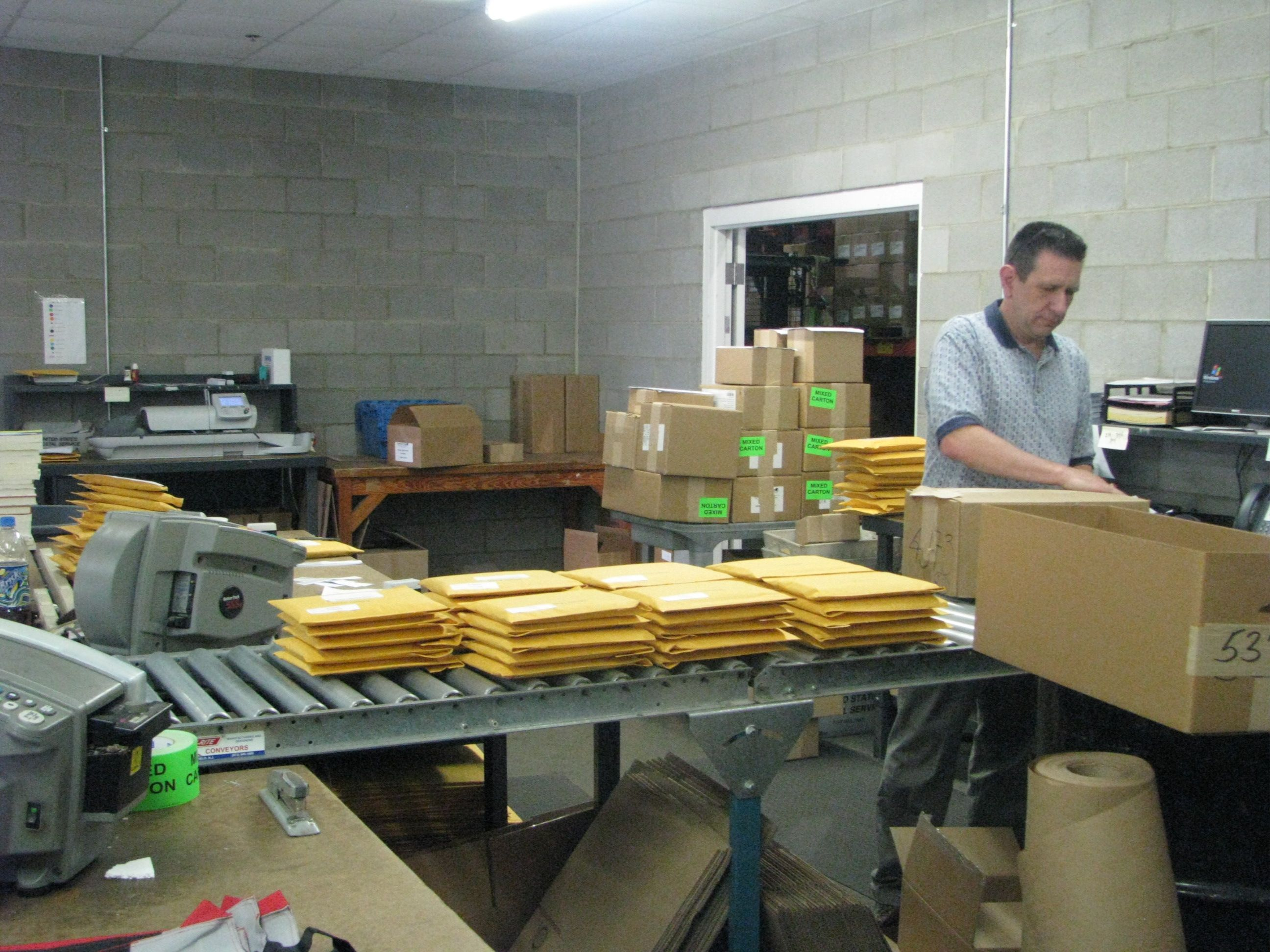 Warehouse manager Don Griffin shipping books to our