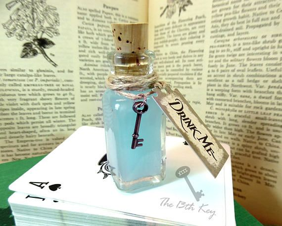 Alice in Wonderland Drink Me Bottle with Tag, Key, and Blue Liquid sold b y The 13th Key on Etsy