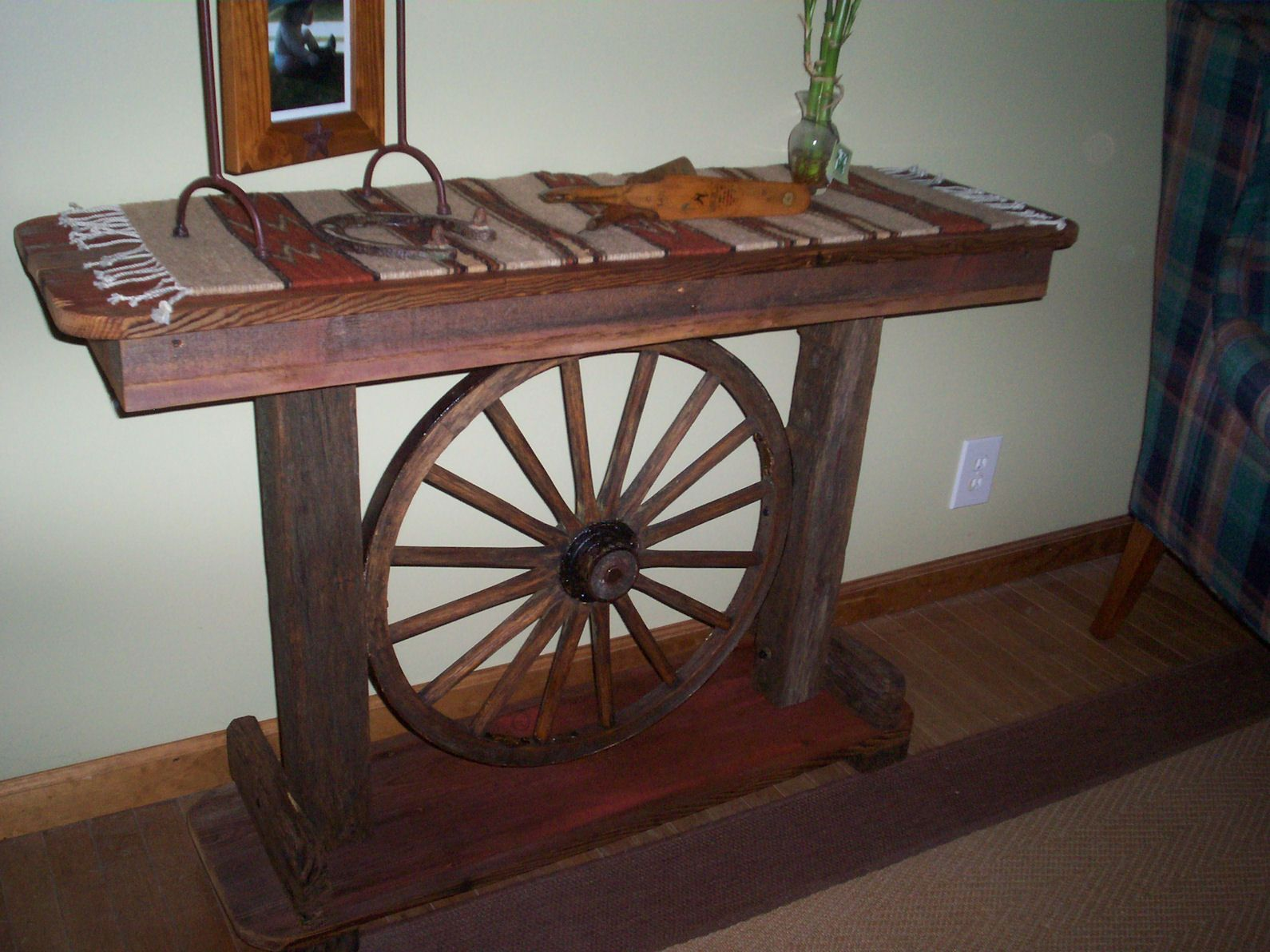 Wagonwheel bench wagon wheel sofa table 1125 for Sofa table on wheels