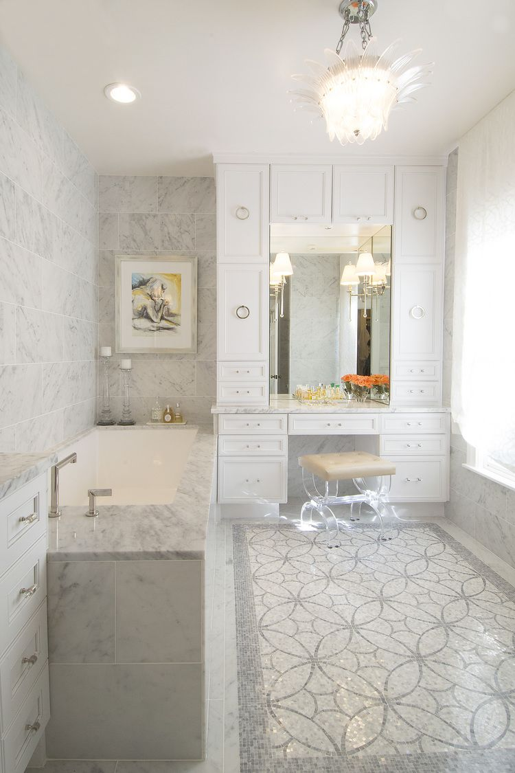 All white bathroom gets depth from varying tile textures and ...