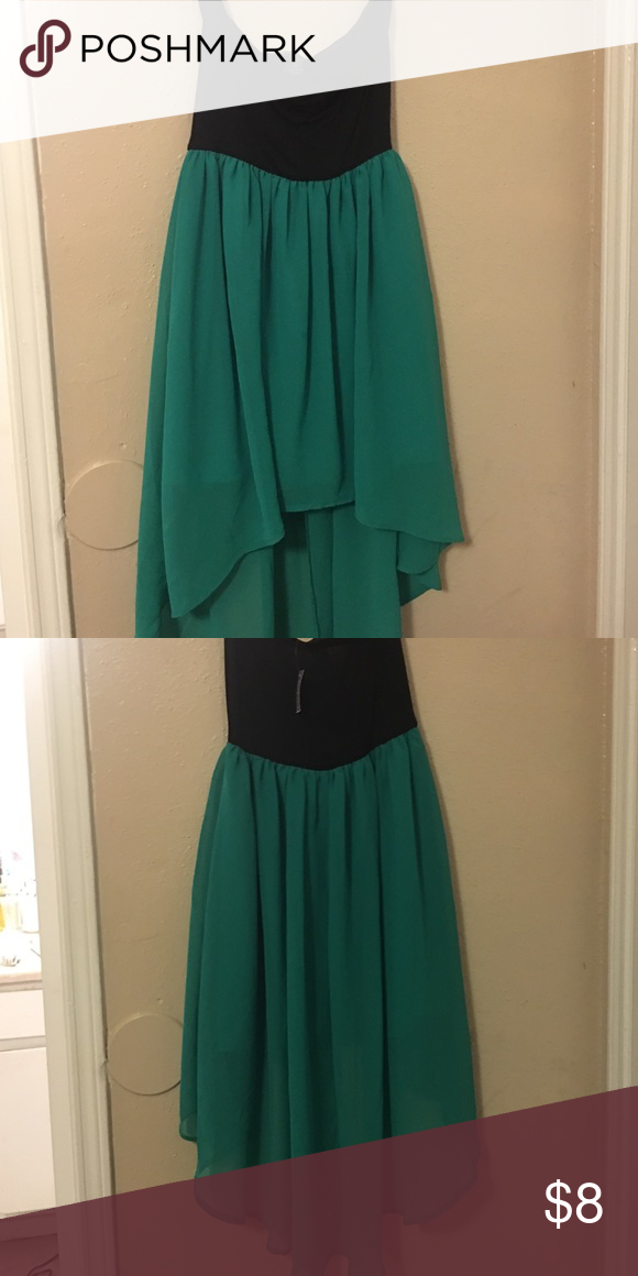 Black and green dress The dress is shorter from the front and longer in the back. It is strapless and very classy. Brand new Wet Seal Dresses Strapless