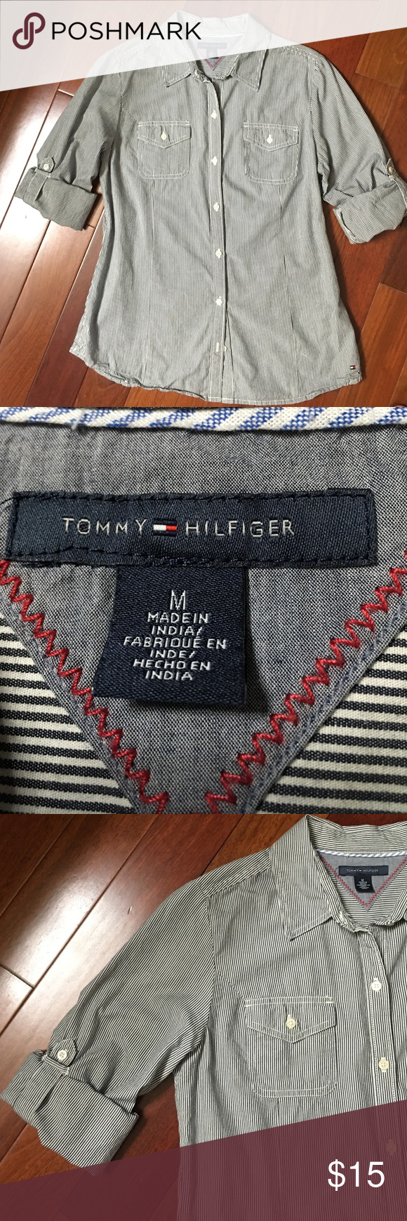 Tomy Hilfiger Navy/White Pinstripe Shirt Tommy Hilfiger button-down longsleeved shirt with roll up sleeves with button fasteners which can be worn either up or down. 100% cotton.   Measures 26 inches from top of shoulder to bottom hem.  19 inches from armpit to armpit.  Like new condition. Barely used. Tommy Hilfiger Tops Button Down Shirts