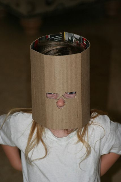 1 piece of cardboard, long enough to wrap around head. some string. Instant shitty knight helmet.
