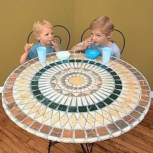 "Tile Table Cover -   • Slip cover over a round, square or multi-sided table (up to 48"")  • Faux-tile finish protects surfaces from spills, just wipe clean  • Cut out the center with scissors to accommodate an umbrella"