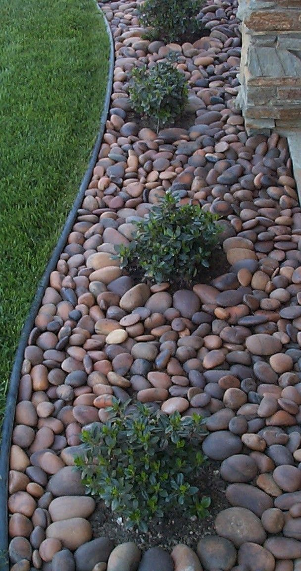 Another landscape look for places where we don't want grass. I usually  don't like rock as much as bark, but I do like the rive rock look here. - Build A Rock Garden In A Day Home And Garden Pinterest Barking