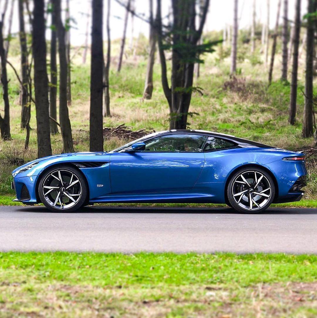 Aston Martin Edinburgh On Instagram The Perfect Car And The Perfect Setting Our Beautiful Intense Blue Dbs Superleggera Aston Martin Superleggera Car
