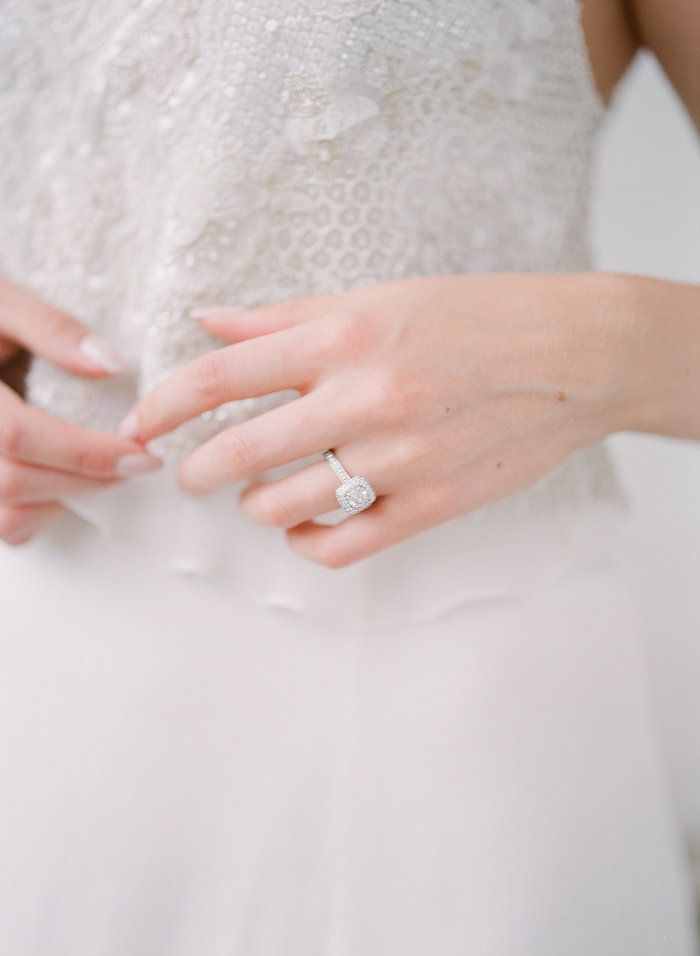 delicate beading on the bodice of this wedding gown and a gorgeous square cut diamond engagement ring.