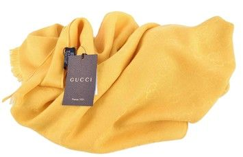 NEW GUCCI YELLOW WOOL SILK GG LOGO SCARF. Get the lowest price on NEW GUCCI YELLOW WOOL SILK GG LOGO SCARF and other fabulous designer clothing and accessories! Shop Tradesy now
