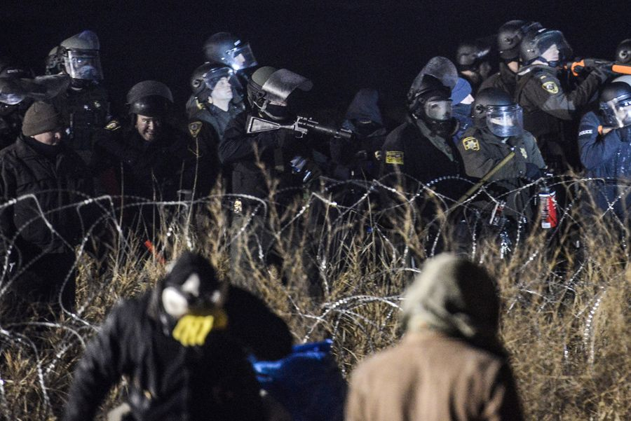 Last night hundreds of Dakota Access Pipeline protesters attempted to force their way through police barricades. They were met with water cannons, tear gas,and rubber bullets, resulting in dozens of injuries.