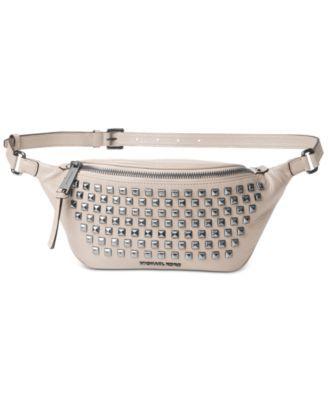 45f3acf04f8a38 MICHAEL KORS Michael Michael Kors Rhea Zip Pyramid Stud Belt Bag. # michaelkors #bags #leather #belt bags #polyester #lining #
