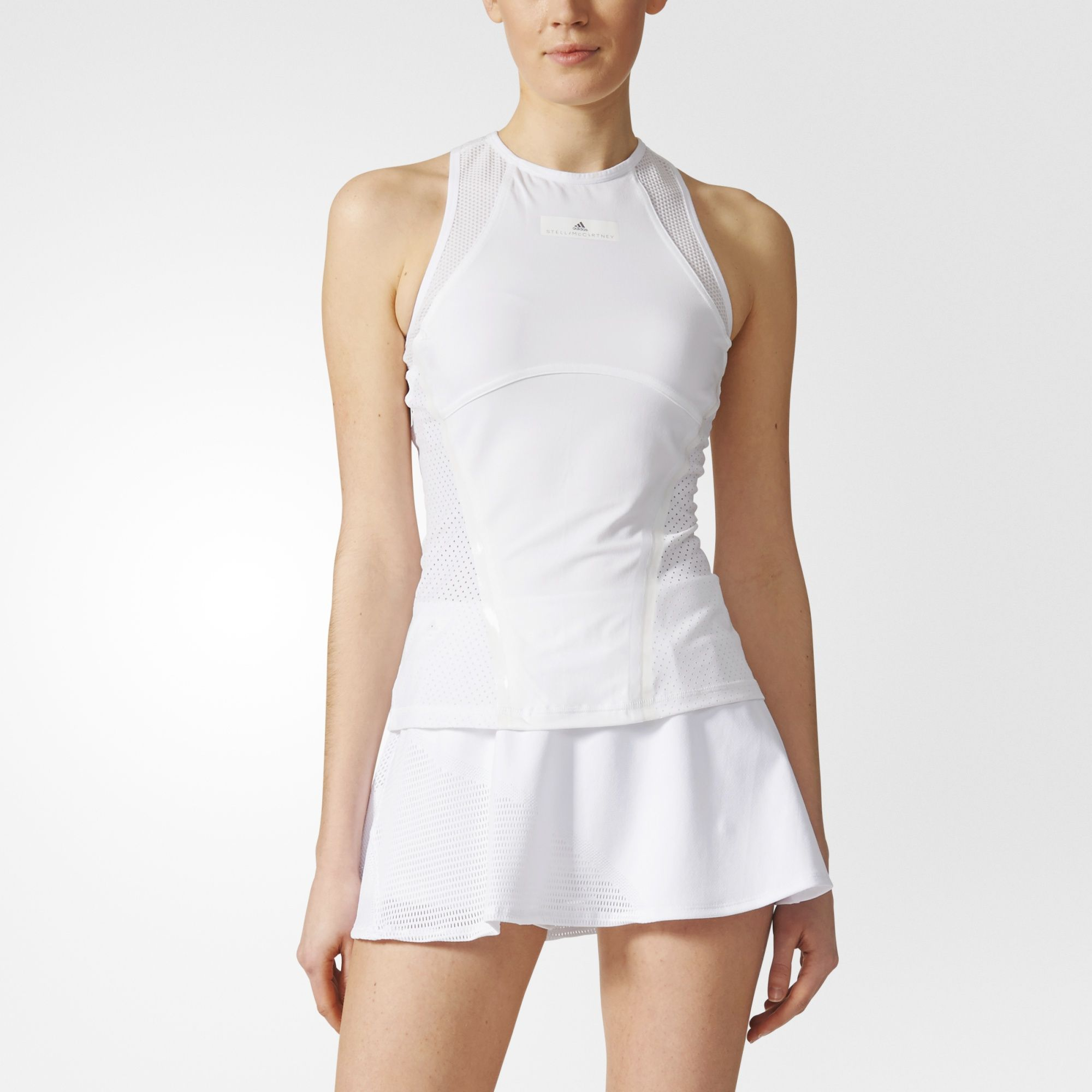 The adidas by Stella McCartney tennis collection combines technical performance with the exceptional feminine tailoring for which Stella is known and loved. A style worn by tennis pros Caroline Wozniacki and Garbiñe Muguruza, this Barricade Tank Top is made of breathable, quick-drying tricot to help you stay cool and dry. Open mesh targets extra airflow where you need it.