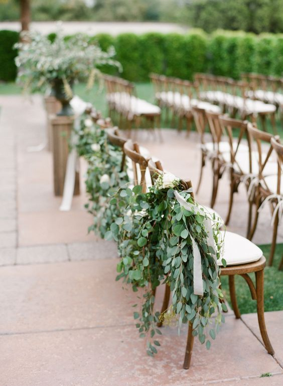 Aisle Chairs Decorated With Eucalyptus And Ribbons