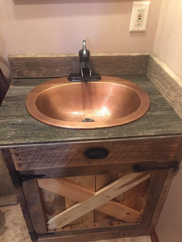 a handmade barnwood vanity from one of