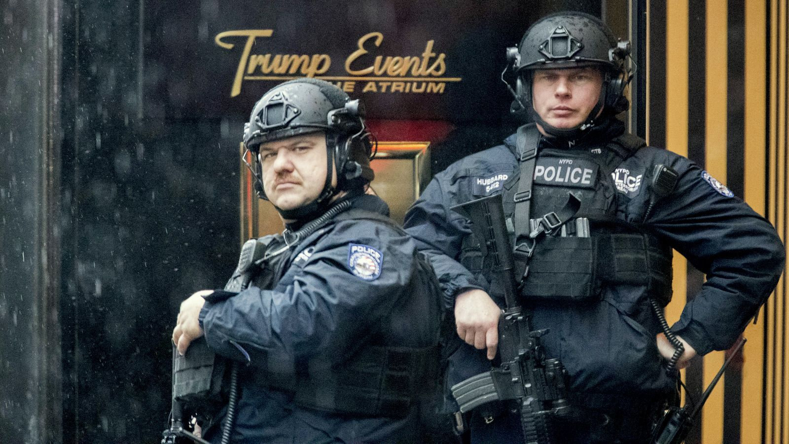 Heavily armed police officers stand guard in the rain outside Trump Tower, Tuesday, Nov. 29, 2016, in New York. (AP Photo/Mary Altaffer)
