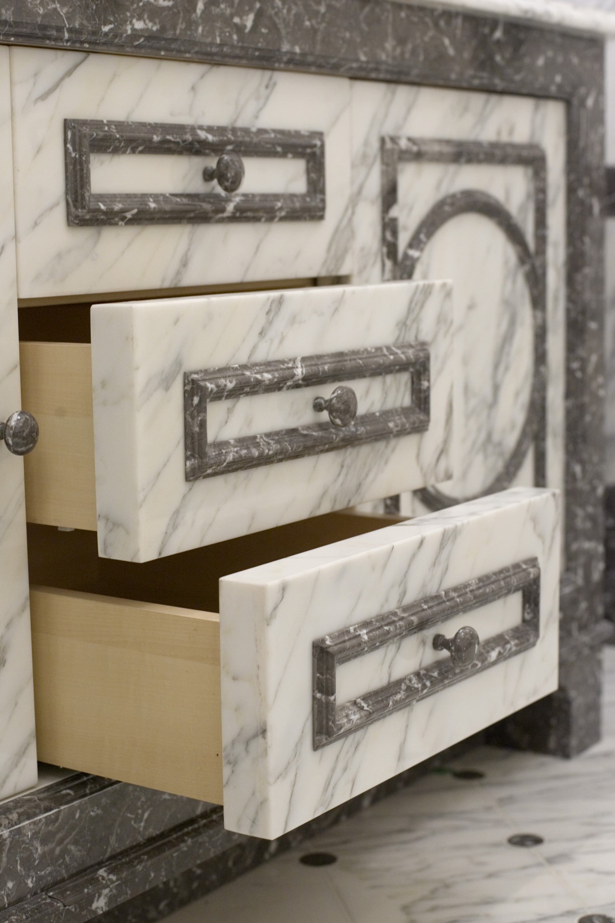 Vanity drawers fronted with statuary marble with grey st anneus