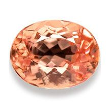 This is the true birthstone for November — Imperial Topaz. An oval just waiting to be set into a beautiful piece.