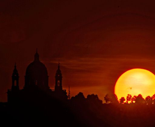 This morning the sight of the majestic sunspot AR 1476 was great as the sun was rising alongside the Basilica of Superga! from Turin, Italy