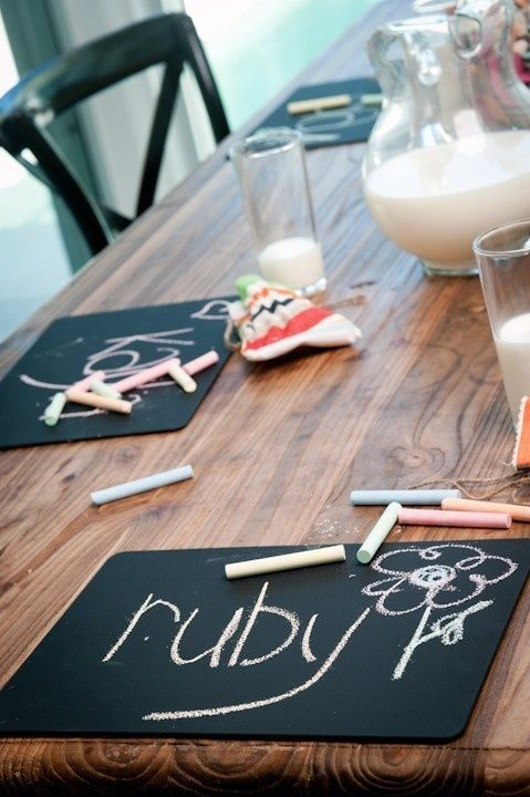 Dollar store place mats sprayed with chalkboard paint to keep kids entertained at the dinner table!