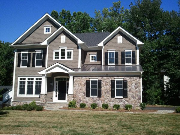 Cheshire Model - New custom home with a partial stone exterior.