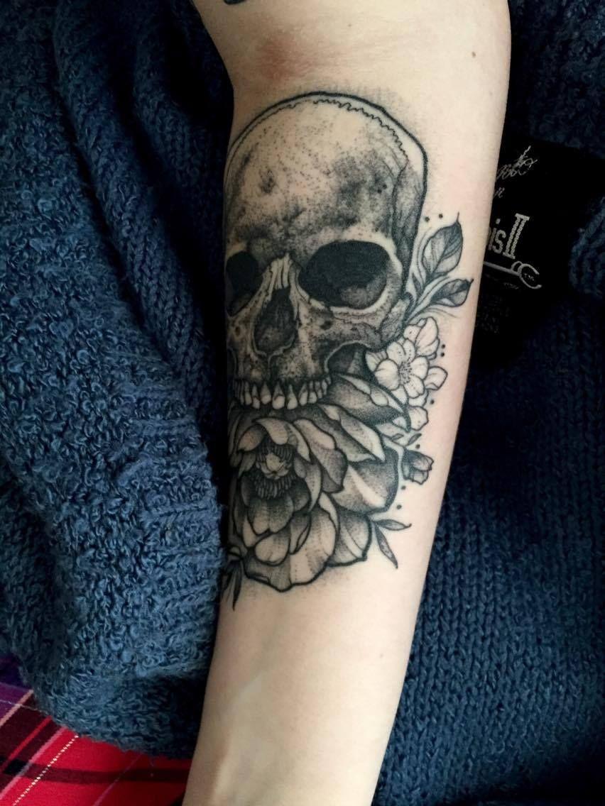 Forearm skull and peony done by thomas bates at indigo