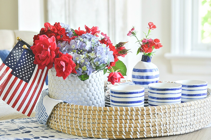 Create a pretty patriotic centerpiece with red, white and blue dishes! EAsy and doable in under 20 minutes! #summerentertaining #summervignette #tablescape #tablescapeideas #summertablescape #redwhiteandblue #patrioticdecor #stonegable