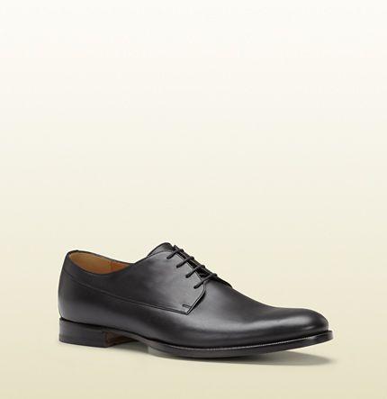ac7dd8ec7d zapatos con cordones de piel negra Gucci