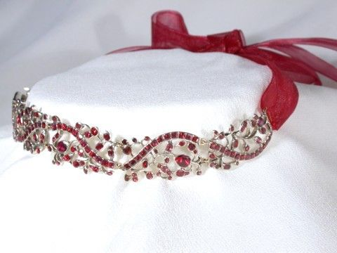 Early Georgian Necklace: ca. 1730-1750, English, over 200 closed back and foiled Almandine garnets (flat cut) are set in rich silver work.