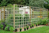 This wood frame garden enclosure is about fifteen feet wide