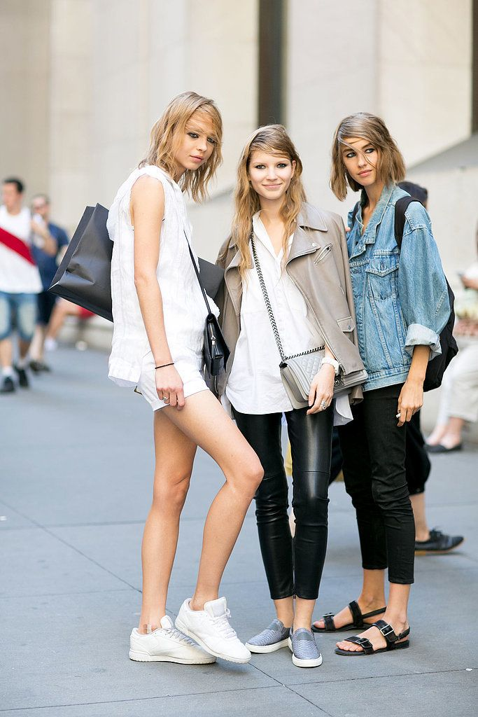 Wear a neutral leather jacket with coated jeans.