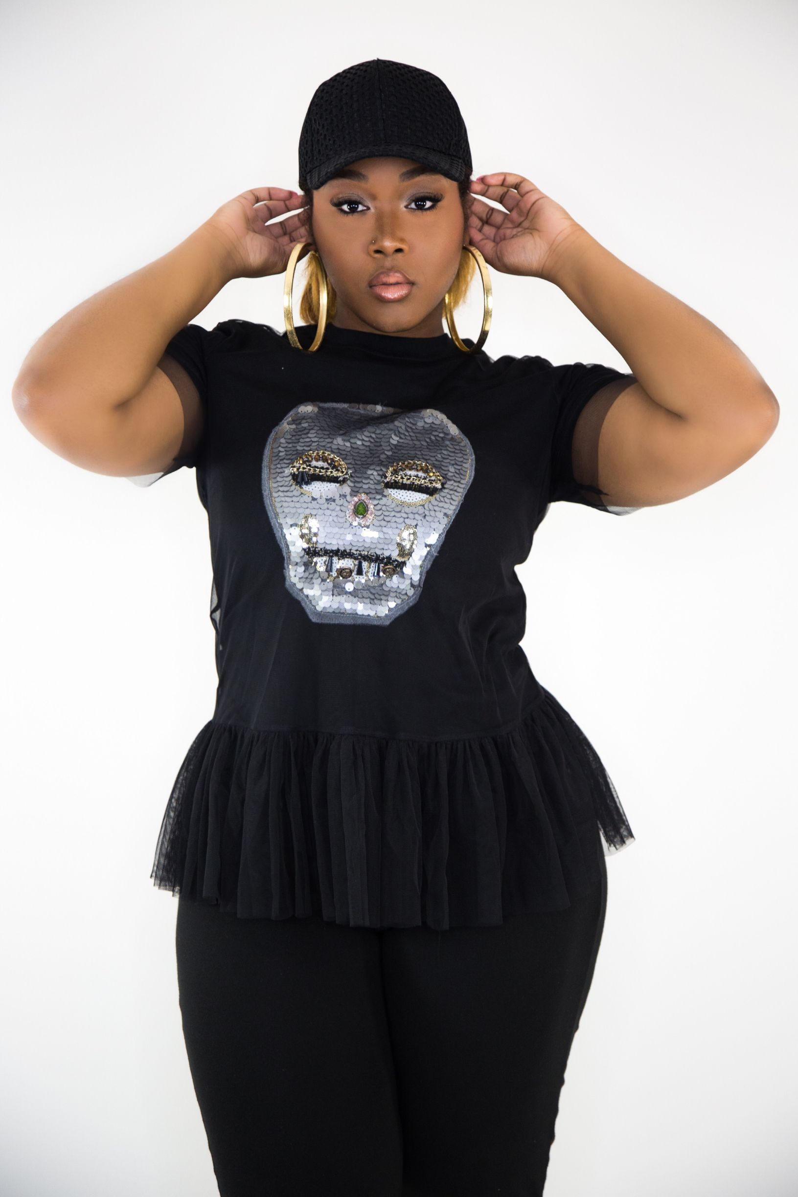 Available in Black  Cotton Undershirt. Jeweled Skull. A thin layer of black tulle peplum.
