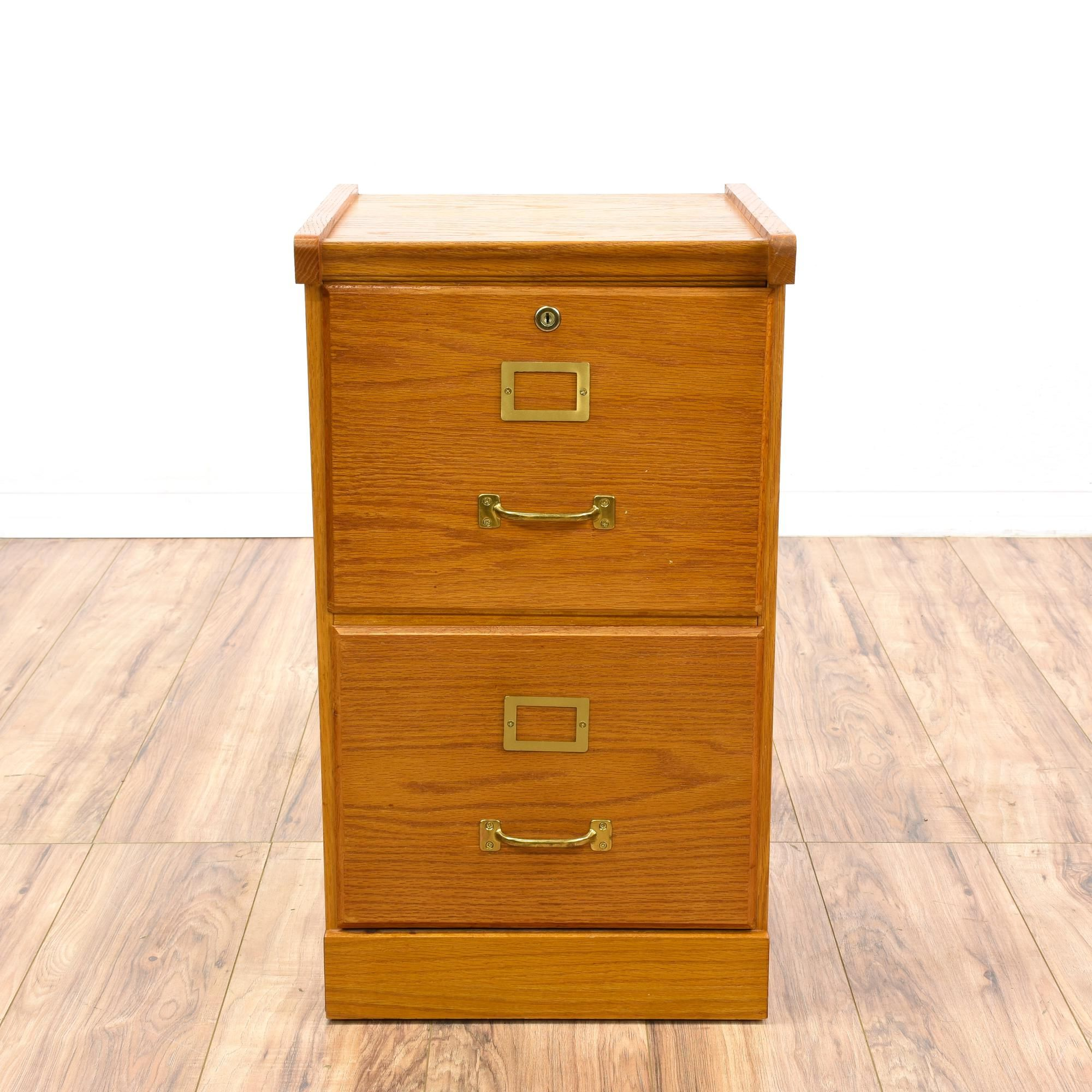 Solid Wood File Cabinet This Filing Cabinet Is Featured In A Solid Wood With An Oak Finish
