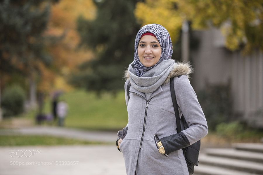 Middle eastern college student smiling on campus by gabledenims middle eastern college student smiling on campus by gabledenims ccuart Images
