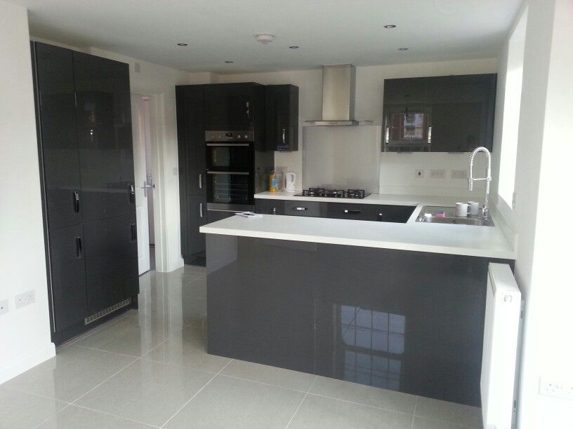 Charcoal Grey Gloss Kitchen Units White Worktops And Grey Tiled