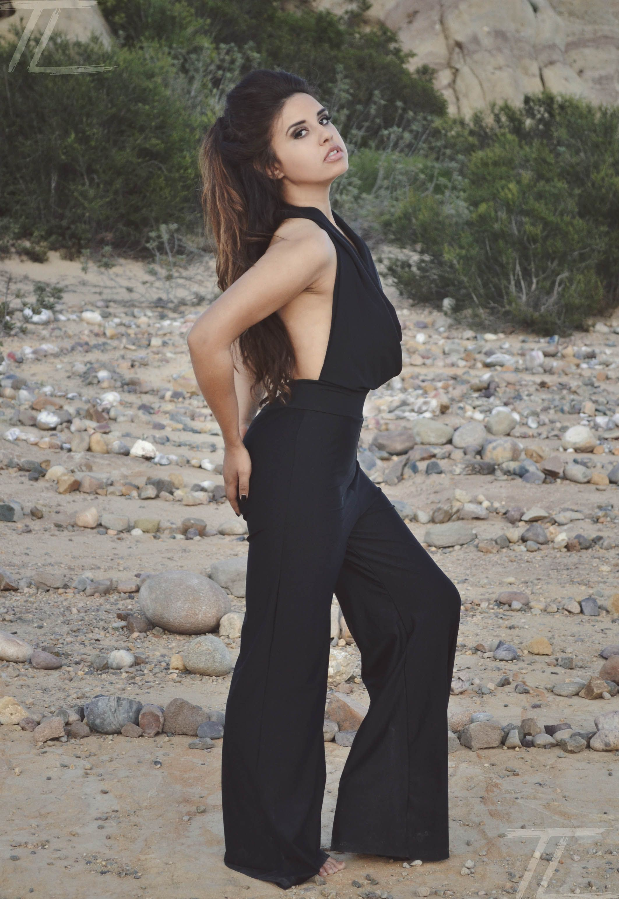 """Dolce Aqua """"Lunah"""" cowl neck backless jumpsuit in black.  The perfect beach cover up that goes from day to night!"""