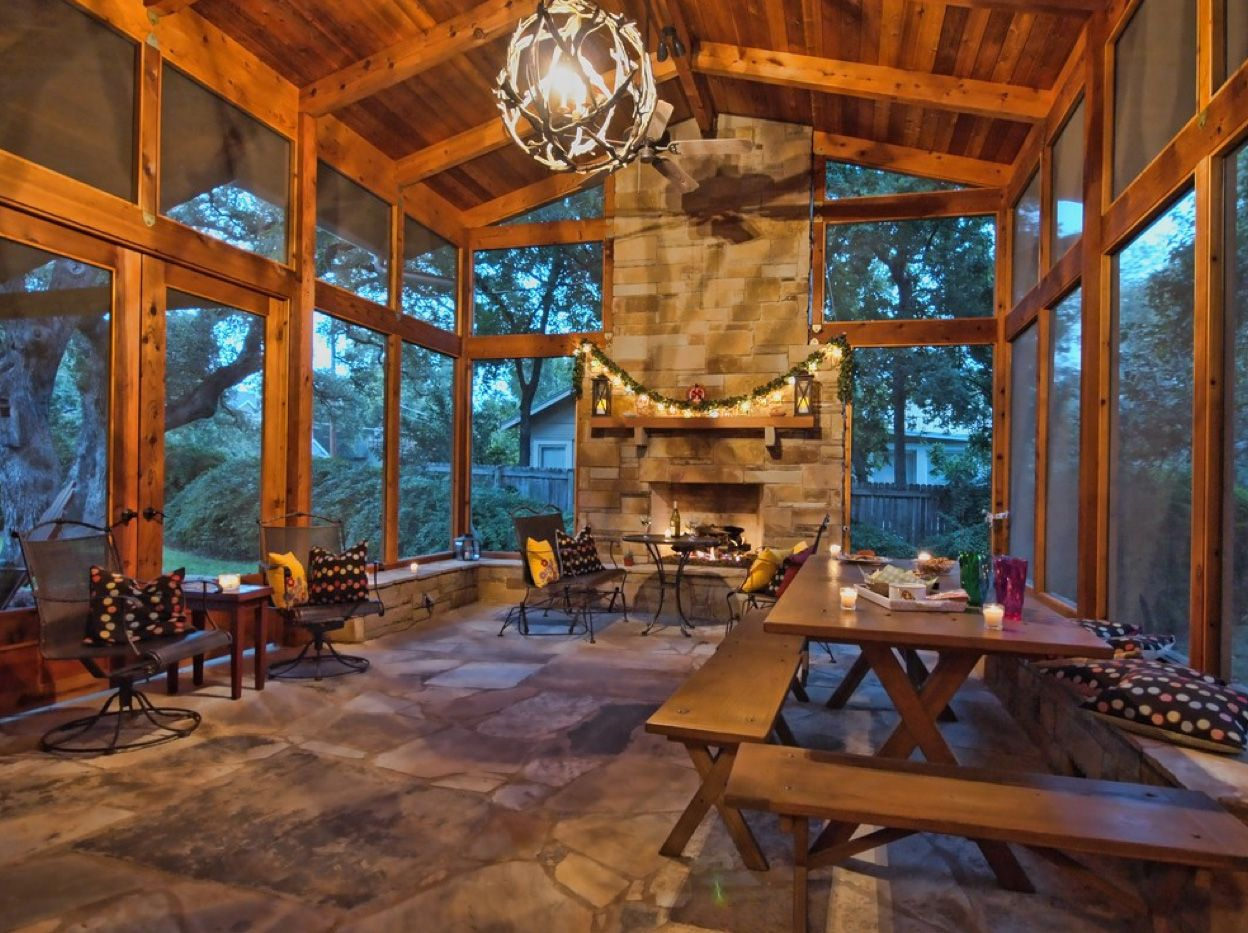 Large Screen Porch With Stacked Stone Fireplace
