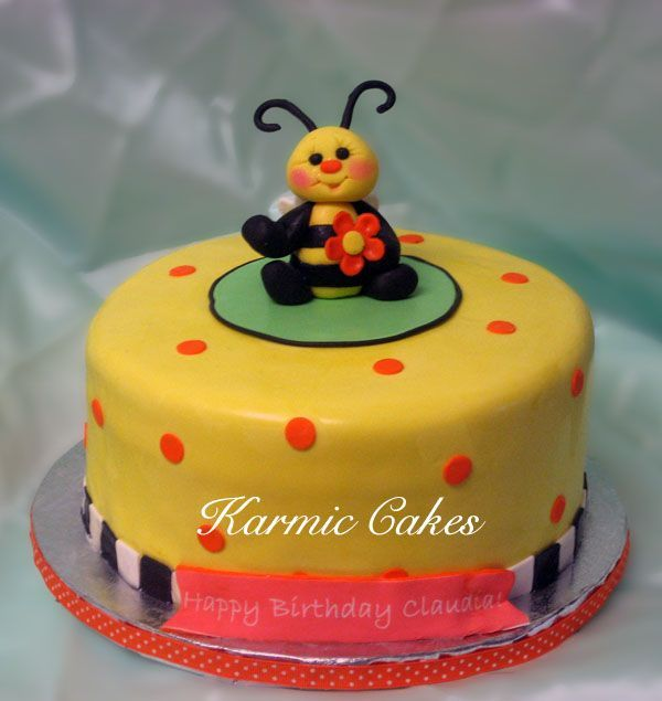 "Bumble bee cake - 8x4"" cake, white butter cake filled with dulce de leche and vanilla buttercream.  Gumpaste bee figurine and covered in fondant."