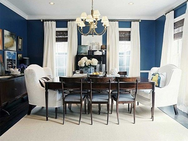 dining room: navy blue accent wall, with white, green, and salmon