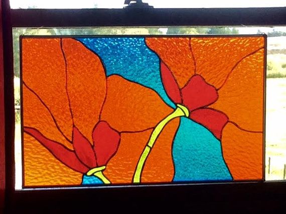 This stained glass artwork was made in my studio, Tristans stained glass in Durango, Co. It is bold and exciting. You will never tire of looking at it :). It is ready to hang with a nice metal frame and hooks. Feel free to contact me with any questions. Thanks ! Ive recently sold a larger version of this window to a happy etsy customer, please read her reiew . SIZE: 20.5 x 12.5