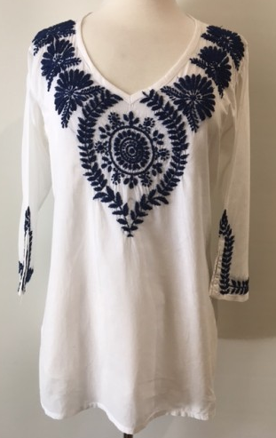 18df59c2e72 Hand embroidered white tunic top made lovingly by individual women in India  under fair trade. 100% cotton v-neck, side slits, quarter sleeves, ...