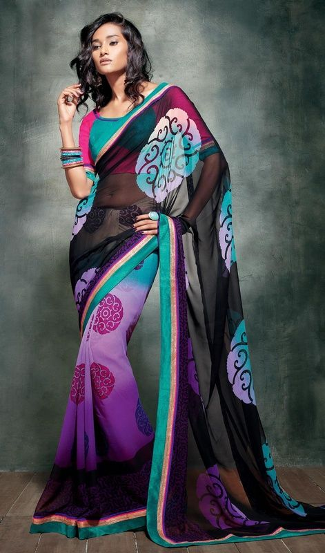 Black, bluish purple and sea green printed georgette sari is perfect for evening party. The sari is embellished with woven lace and printed border and scattered motifs which gives you an grand and exquisite look. Sari comes with contrast fuchsia and sea green raw silk stitched blouse as shown in the picture. #PrintedDesignCasualSaree