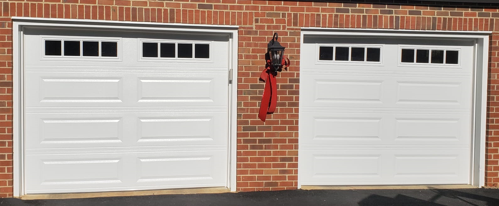 Two 9x7 Model 4251 Long Panel Garage Doors With Top Square Madison Glass Installed By The Richmond Store Teamappledoor Garage Doors Garage Door Panels Doors