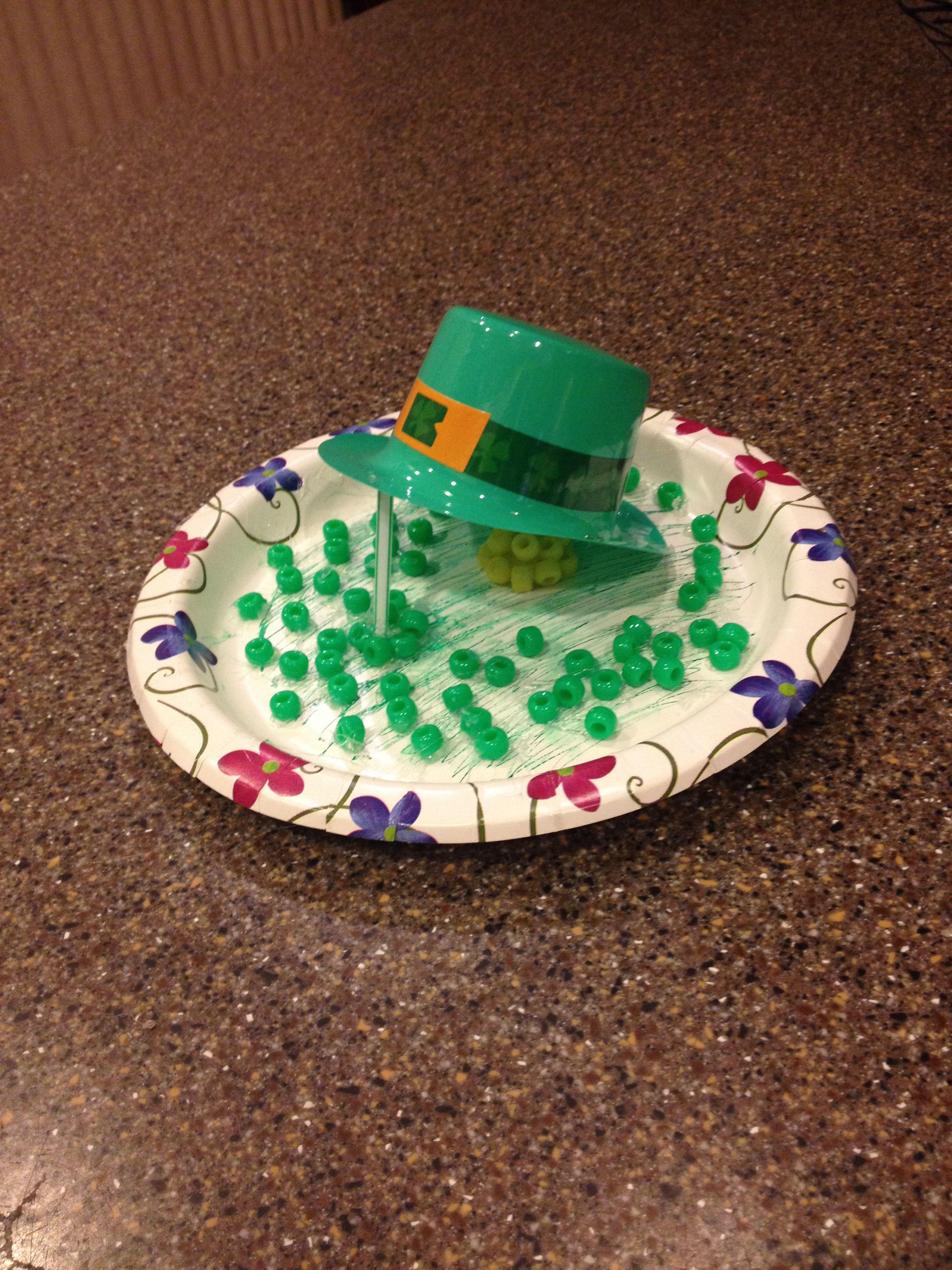 9:30 night before St. Patricks Day Leprechaun trap. Plate, bendable straw, hot glue, beads & a plastic mini hat. #leprechauntrap #stpatricksday #fastandeasy