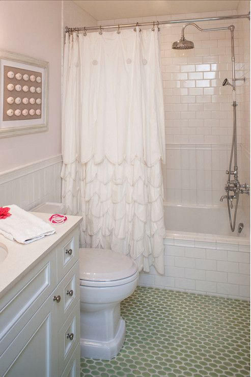 Coastal Bathroom Features Brick Laid Subway Tile Over